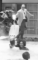 Hotel owner pouring acid into their pool with Africans
